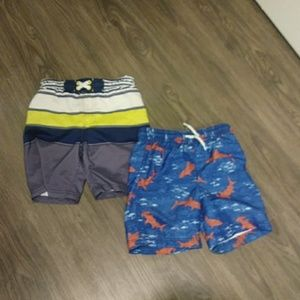 Two pairs of boys swim trunks